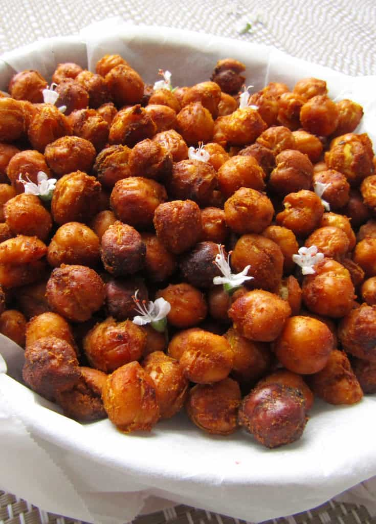 crunchy oven roasted chickpeas flavoured with cumin and garnished with white flowers