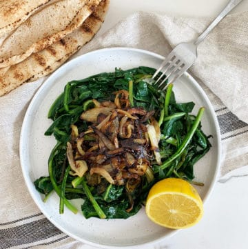 Sauted chicory leaves garnished with golden brown onions served with lemon. This is a Lebanese recipe known as Hindbeh Bi Zeit