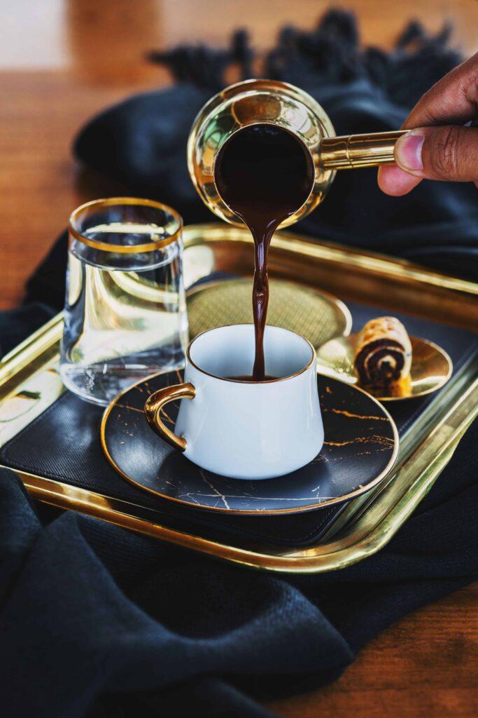 Raqwa - Lebanese Coffee Pot being used to serve strong black coffee
