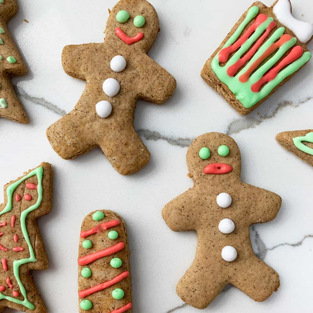 Gingerbread cookies for Christmas decorated in green, red and white royal icing