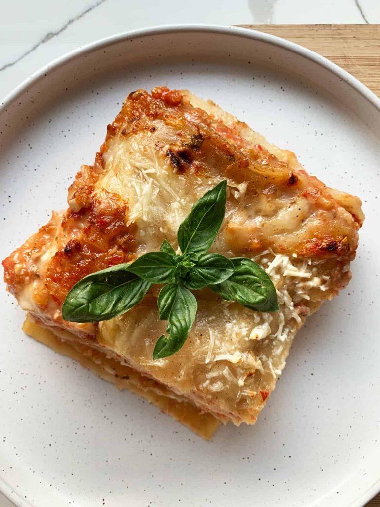 vegan lasagna garnished with basil