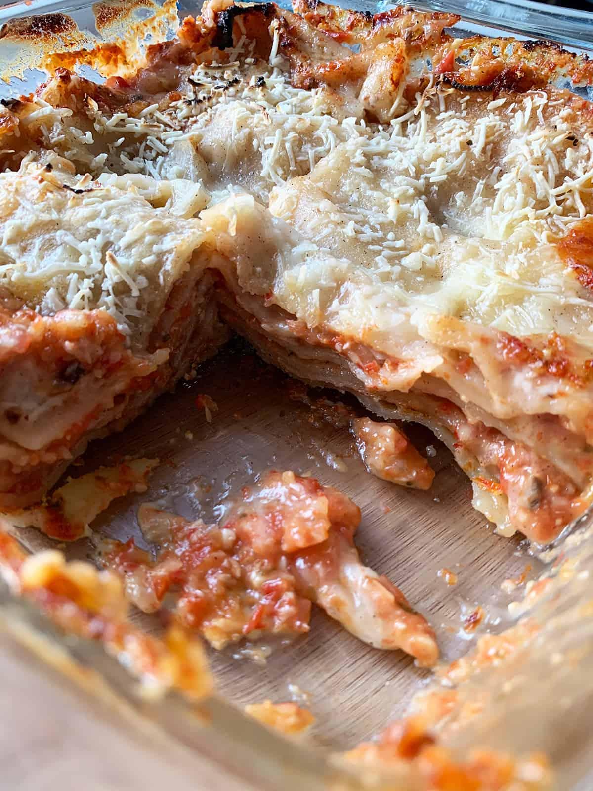 vegan gluten free lasagna up close with a piece missing