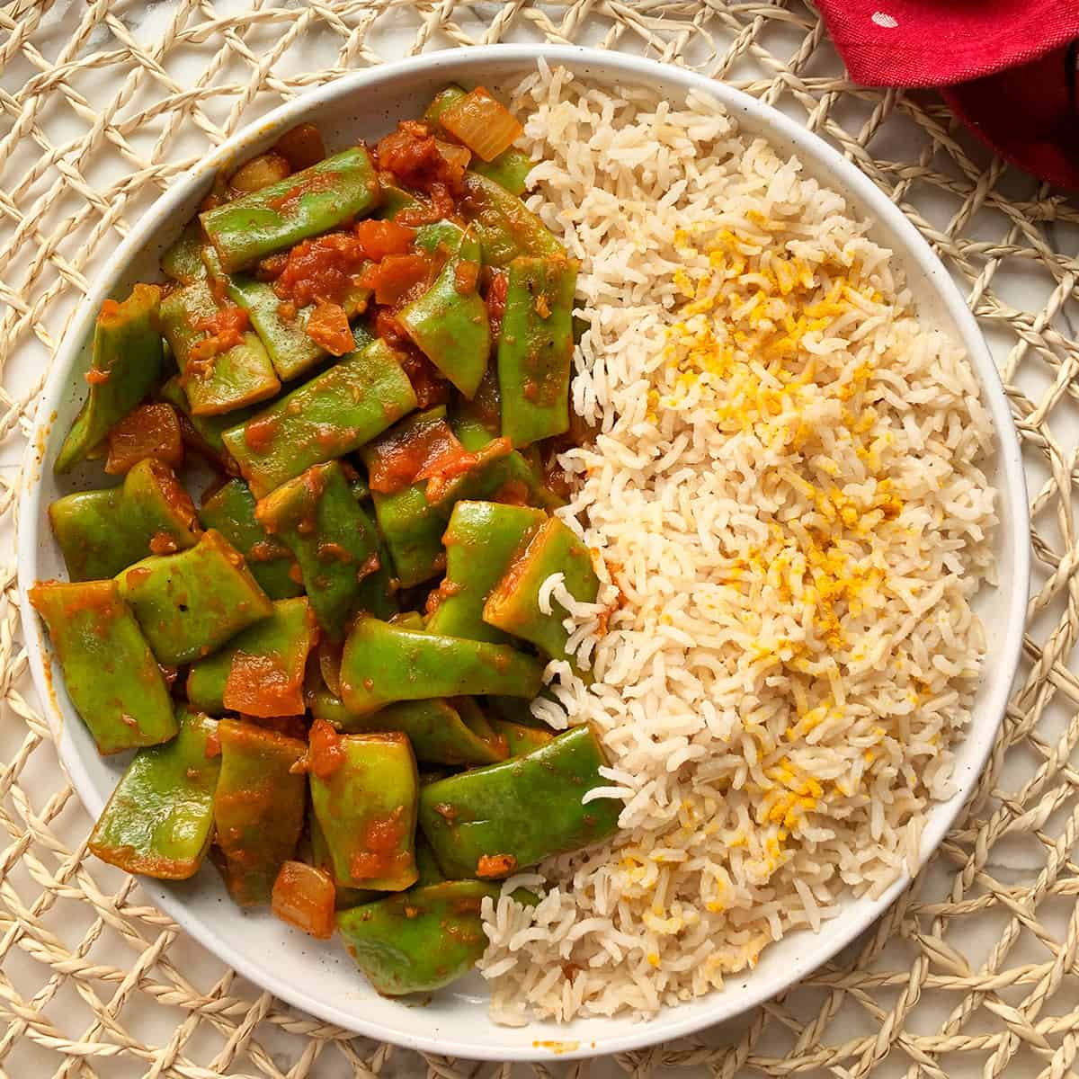 Green Bean Recipe served with basmati rice served on plates