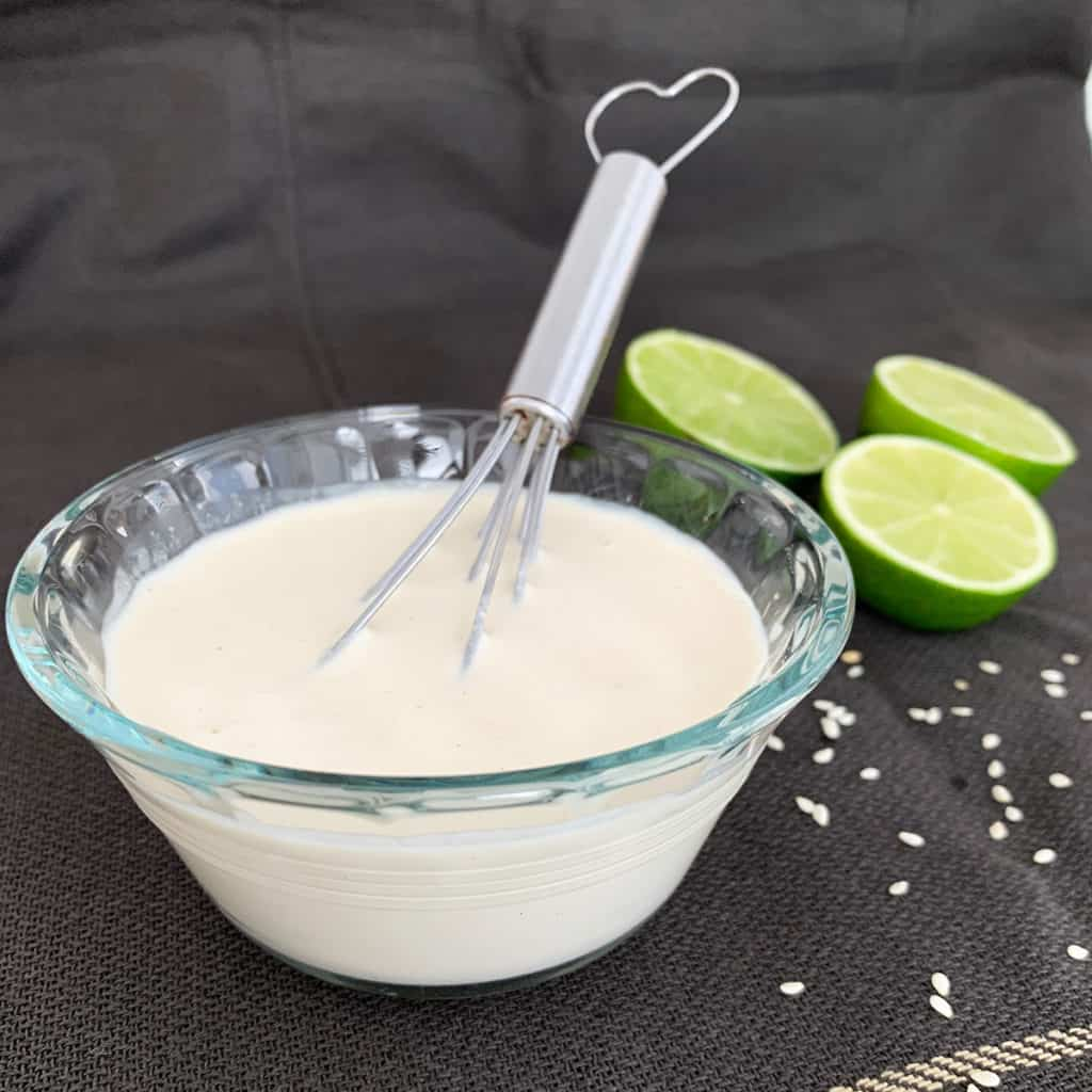 falafel dipping sauce with lime on a grey background