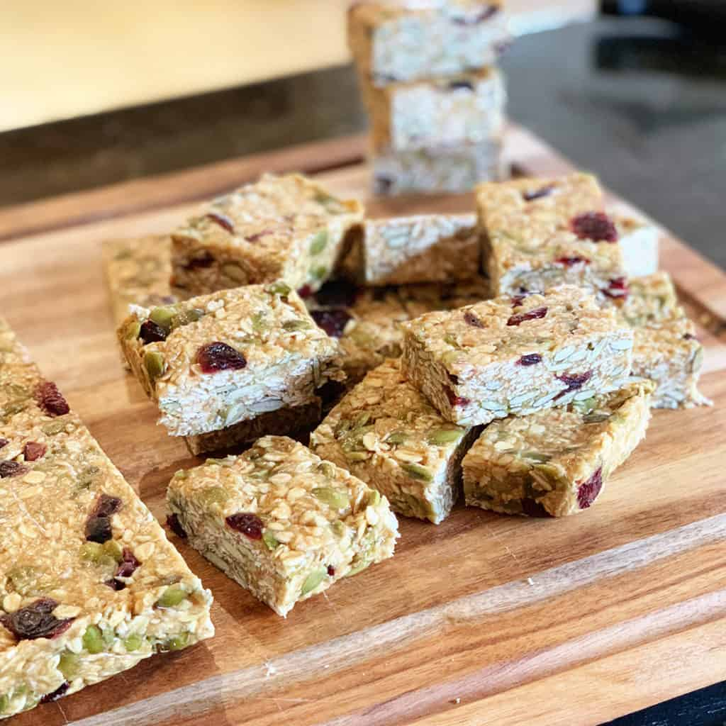 Home made granola bar cut up on a chopping board