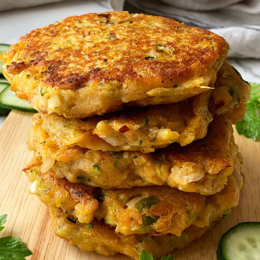 A close up of a stack of sweet potato and zucchini fritters