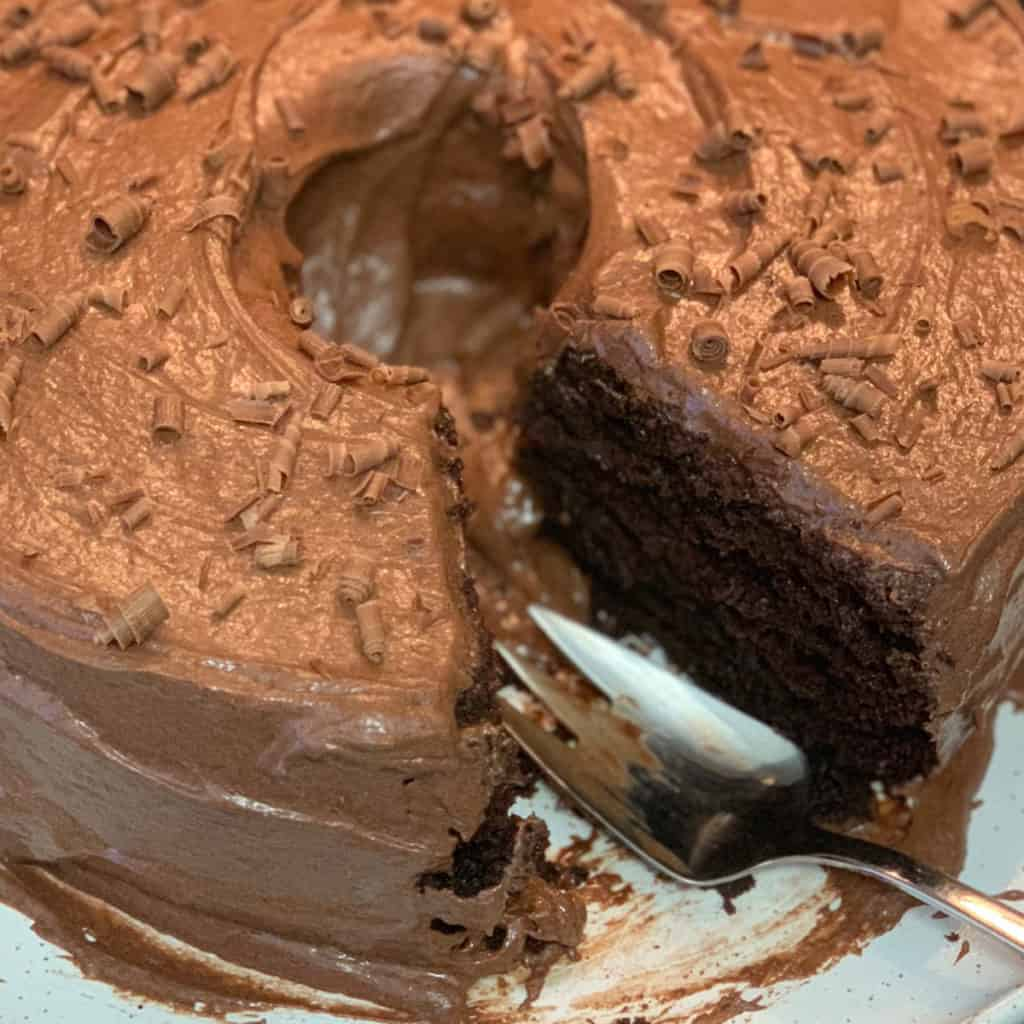 Chocolate Zucchini Cake with a slice missing