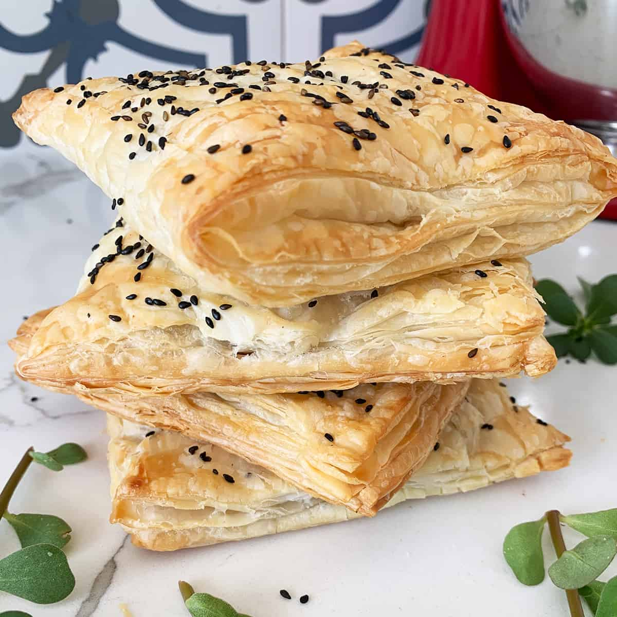 Purslane pastry pockets stacked in four
