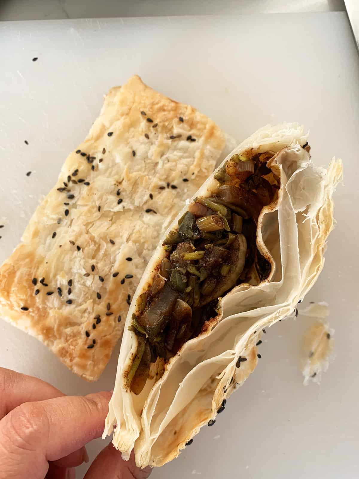 Inside of a cooked purslane/bakleh pocket