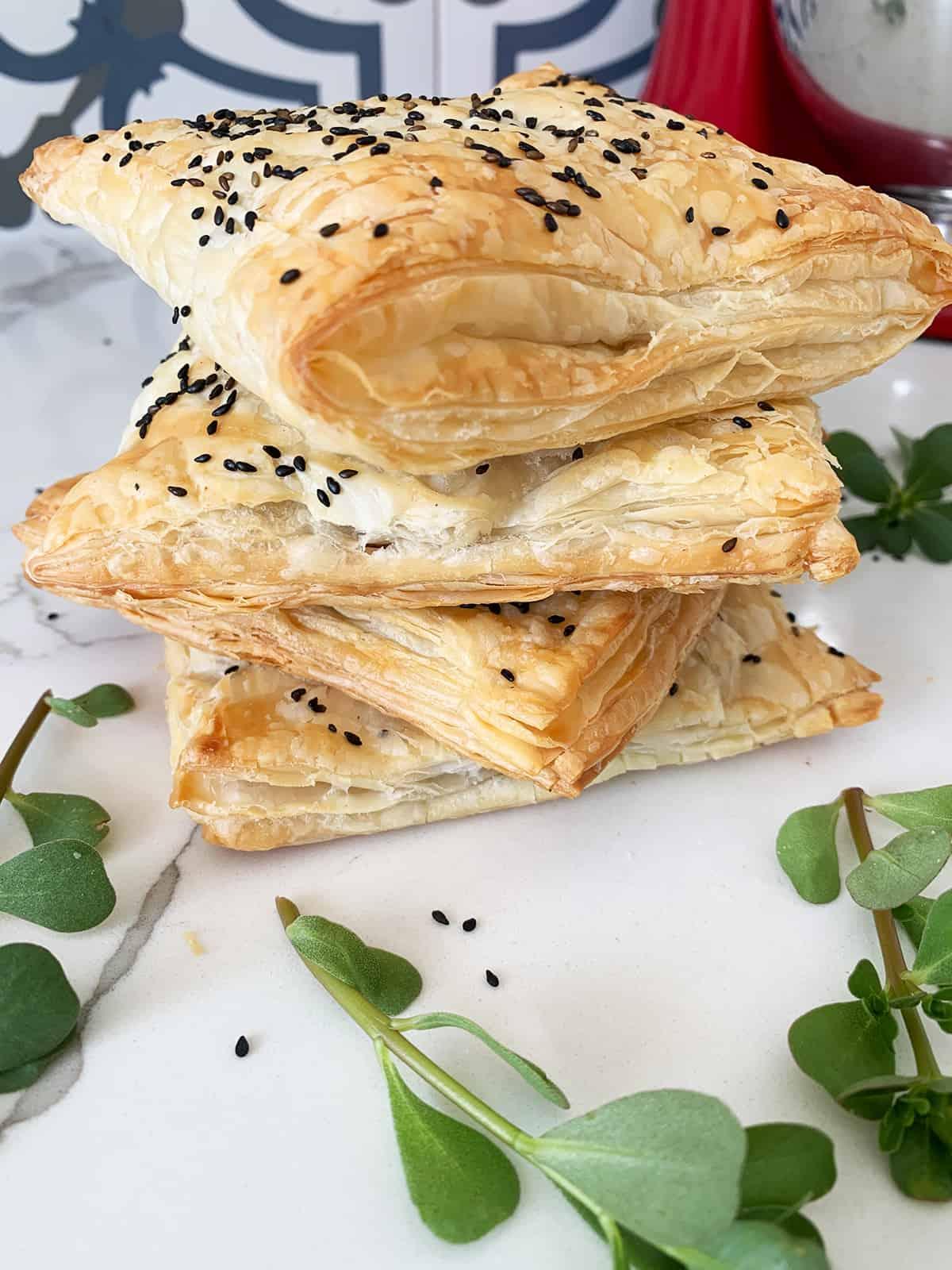 Purslane/bakleh recipe pockets stacked in four