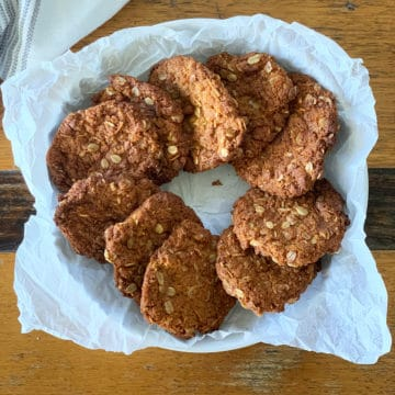 ANZAC biscuits on a white plate