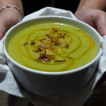 vegan broccoli soup in a white bowl