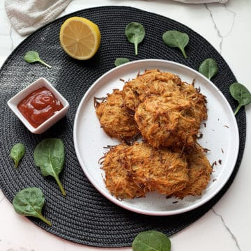 baked vegan hash browns served with tomato sauce
