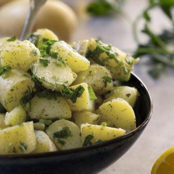 Lebanese Potato Salad (salata batata) in a dark blue bowl