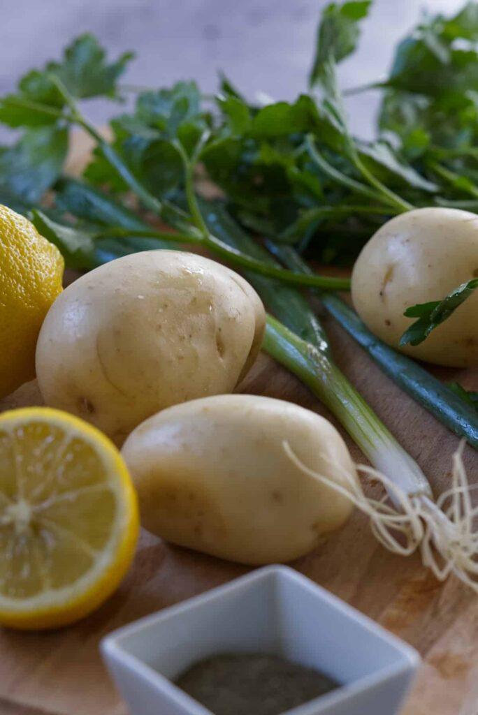 Lebanese potato (salata batata) ingredients including lemon, dried mint, parsley, potato and shallots