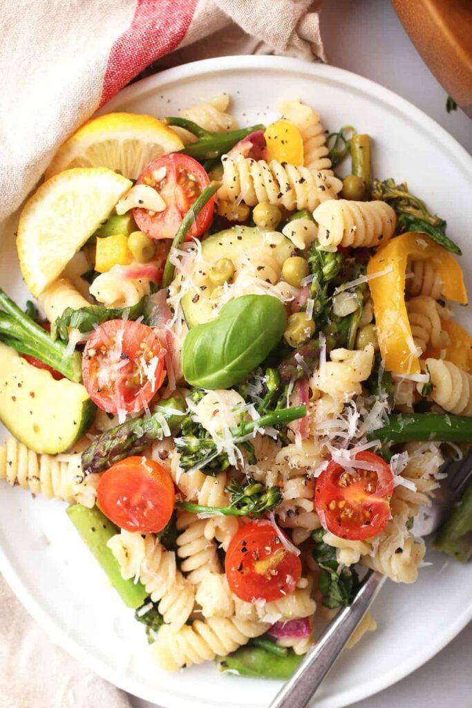 pasta primavera salad in a white plate