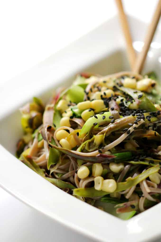 soba pasta noodles in a white bowl with chopsticks