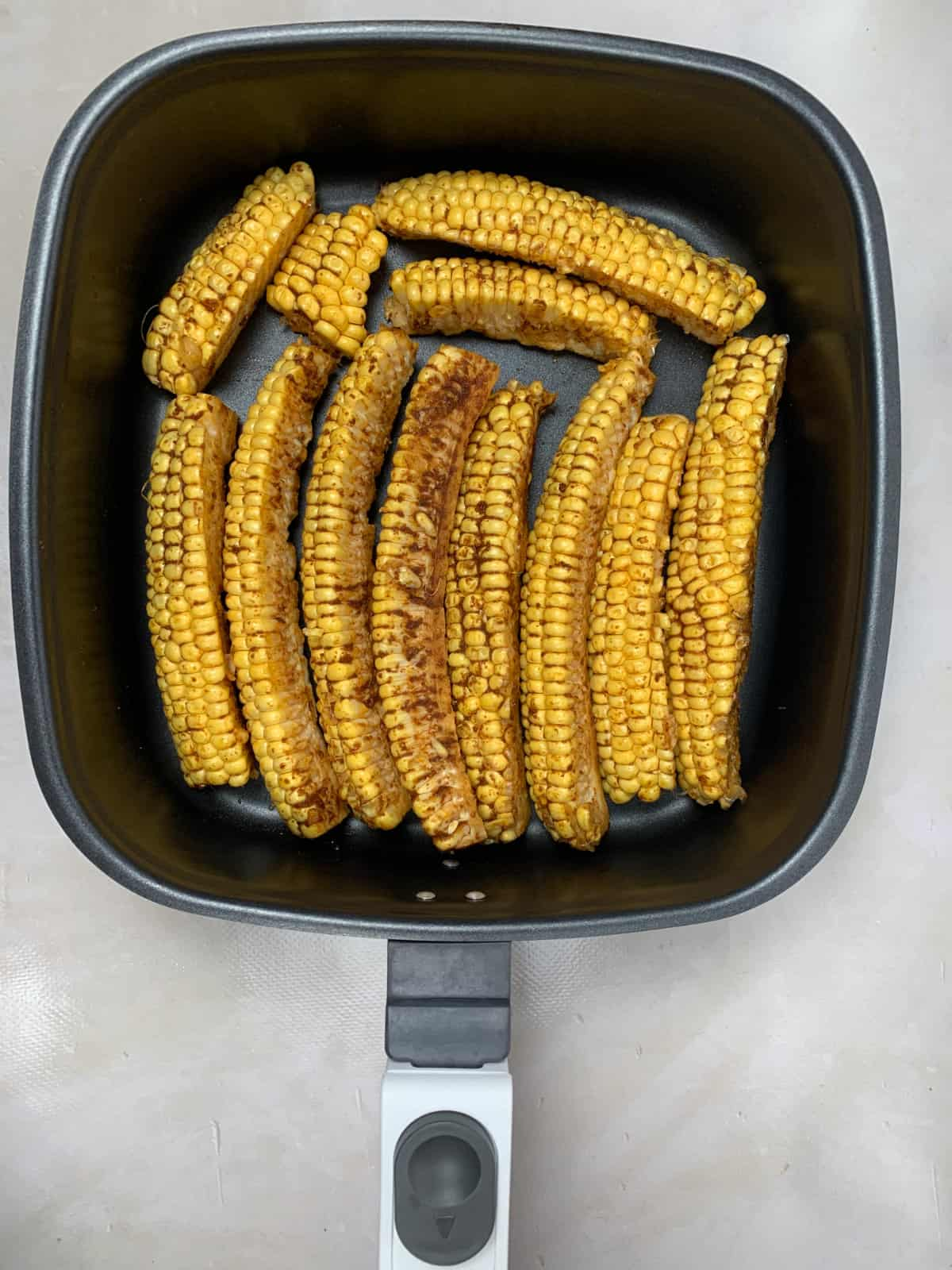 cooked corn ribs in air fryer pan