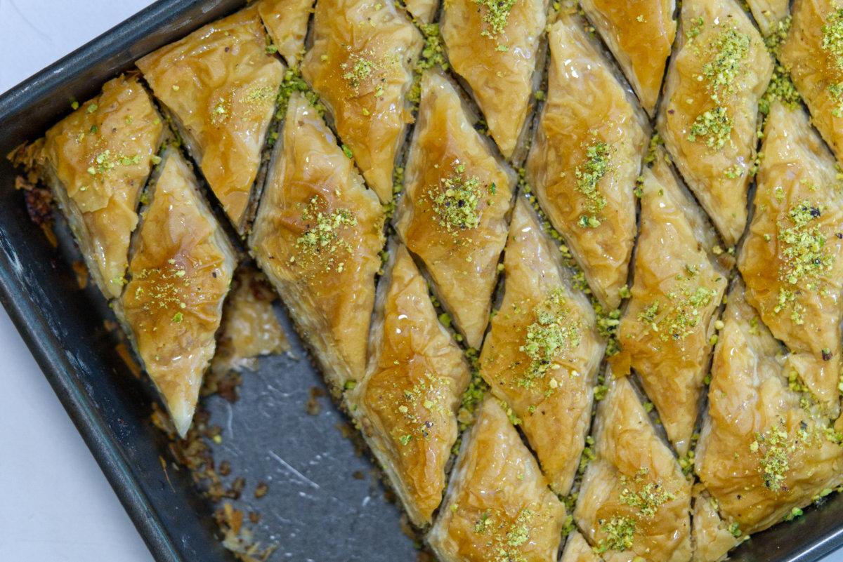 fresh Lebanese baklava in a tray cut up