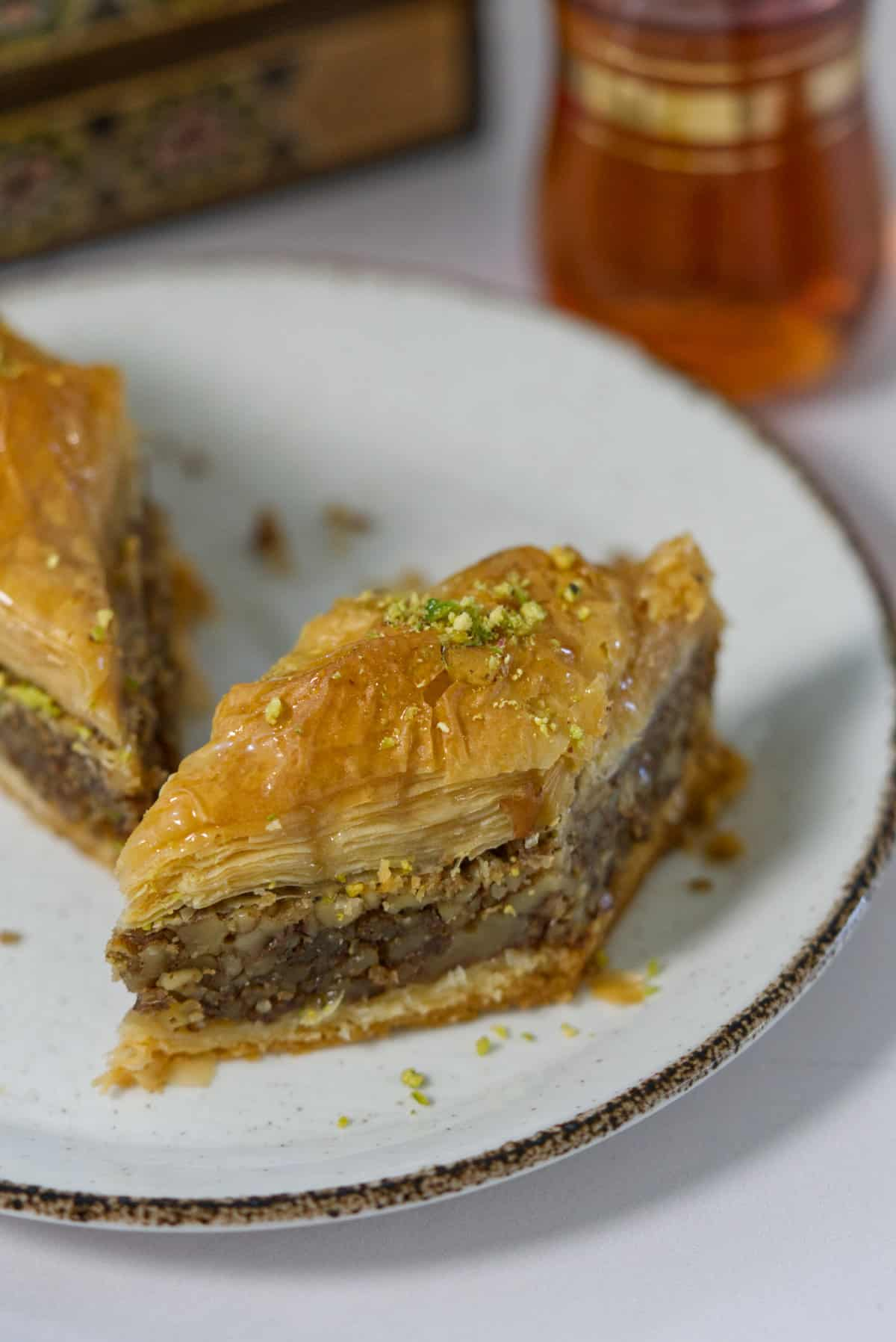 A couple of pieces of baklawa on a plate