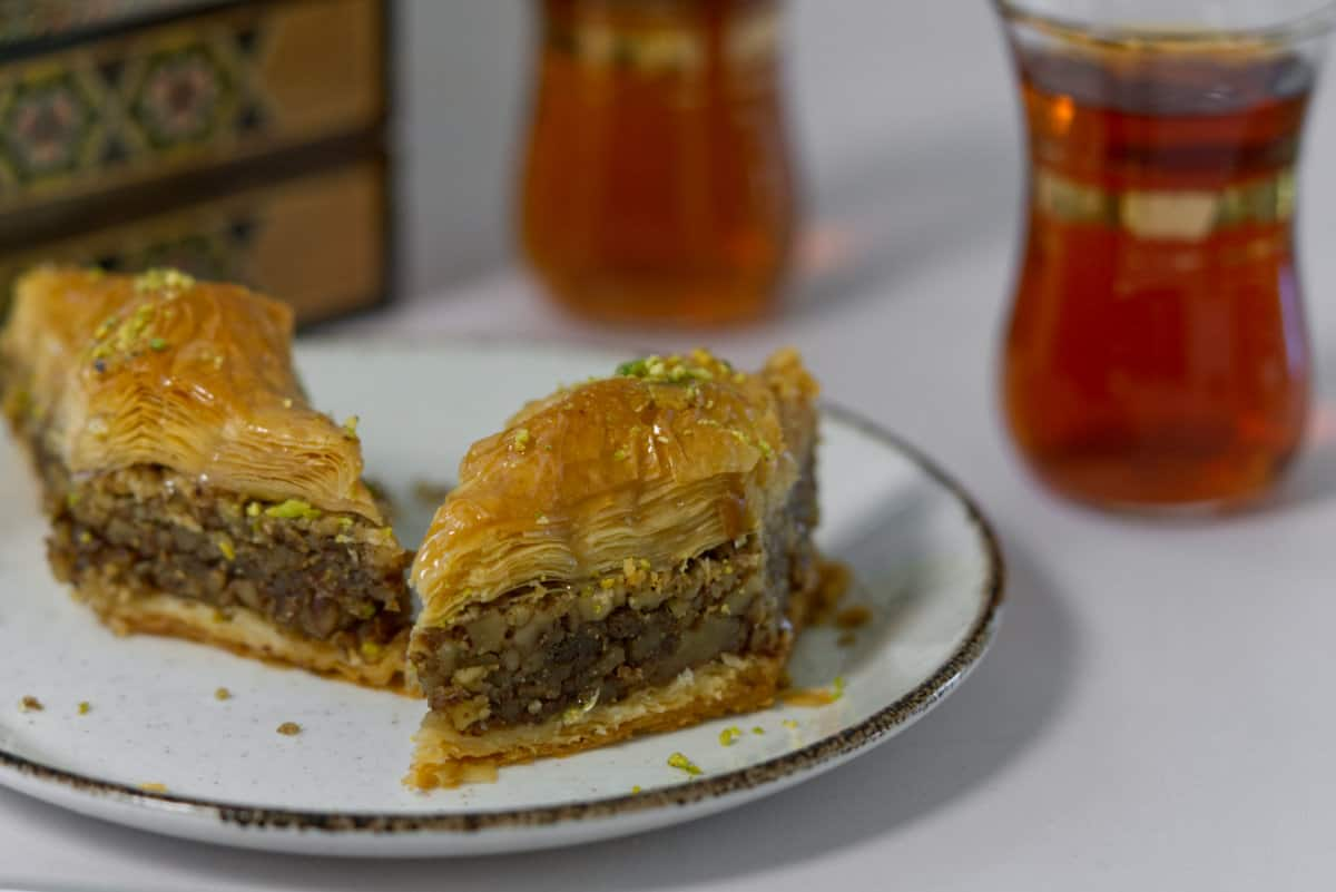 baklawa with tea in the background