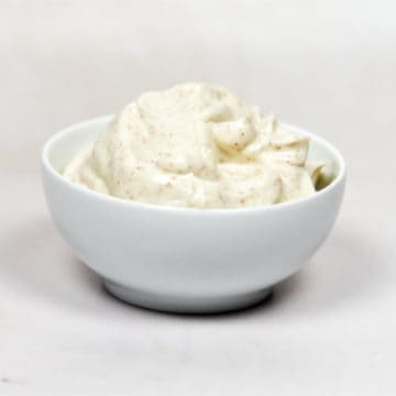 Eggless mayonnaise in a white bowl