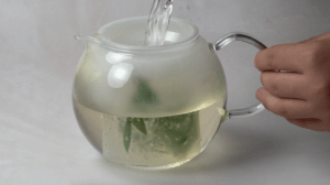 pouring boiling water to tea pot