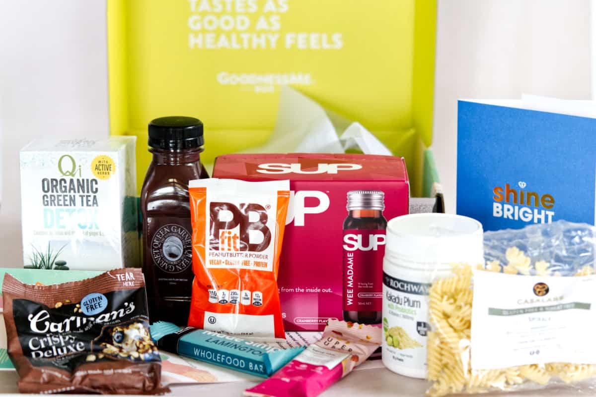 Self care subscription box contents inlcuding organic green tea, gluten free pasta, kakadu plum...