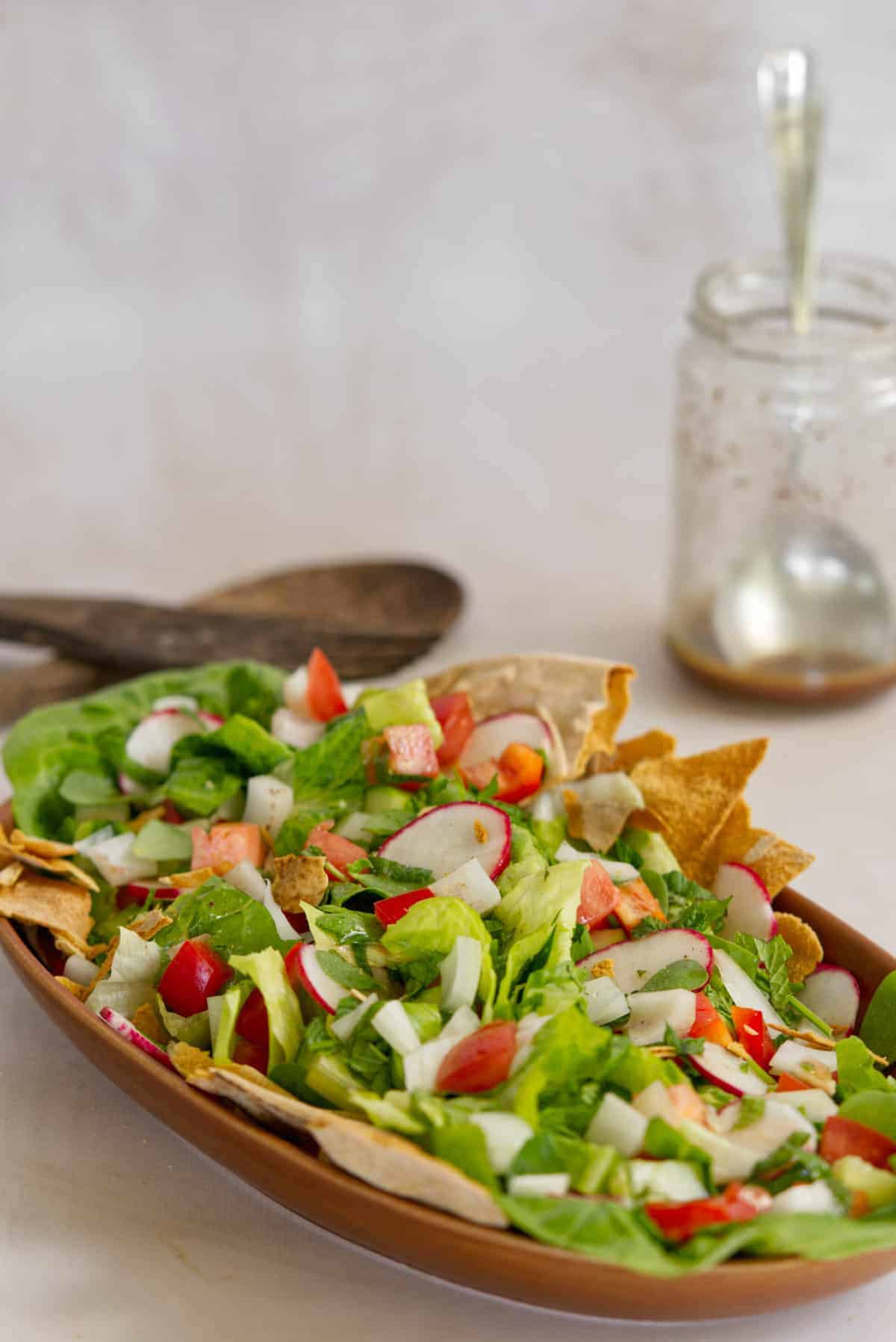 fattoush lebanese salad in a brown plate