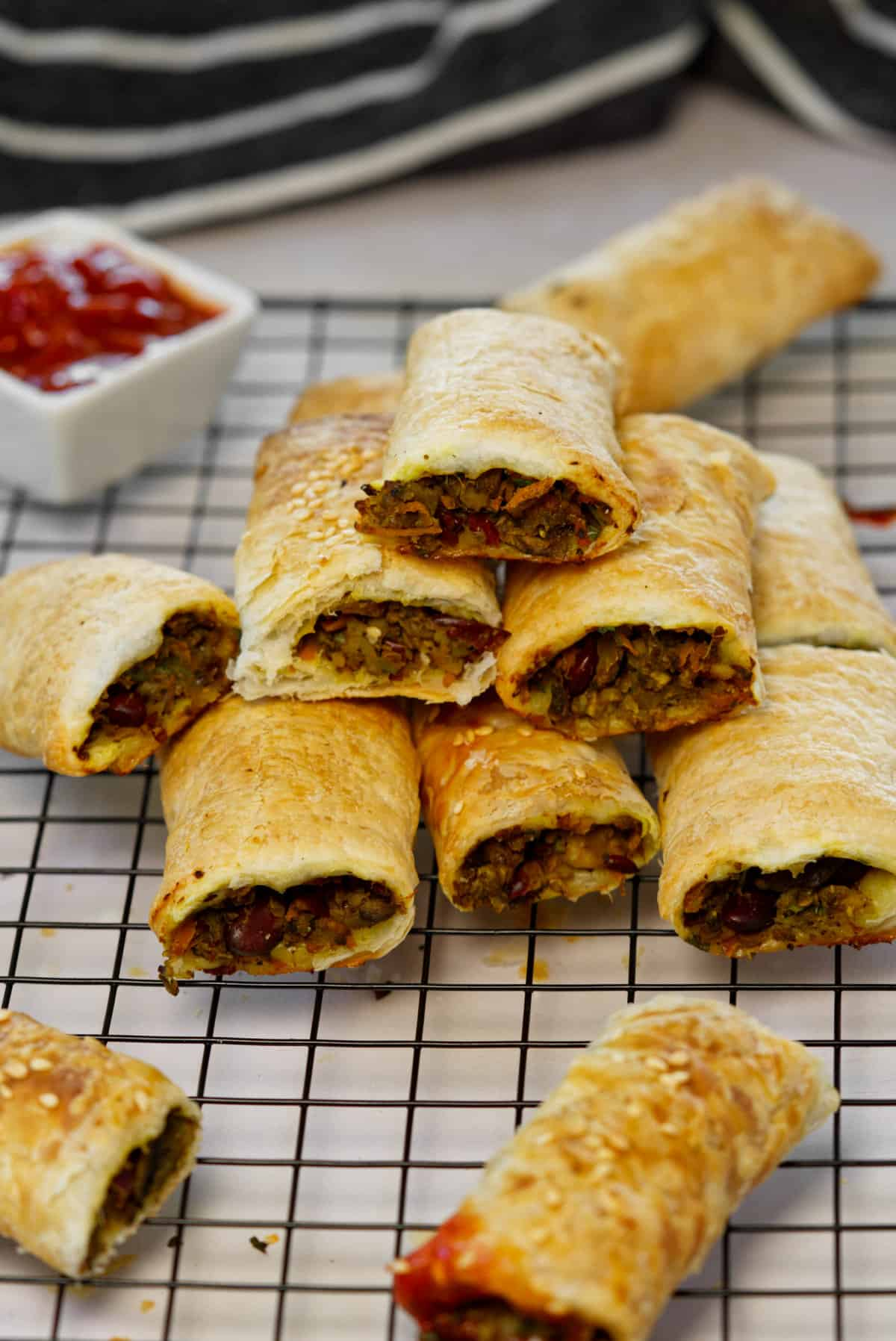 vegan sausage rolls stacked on top of each other