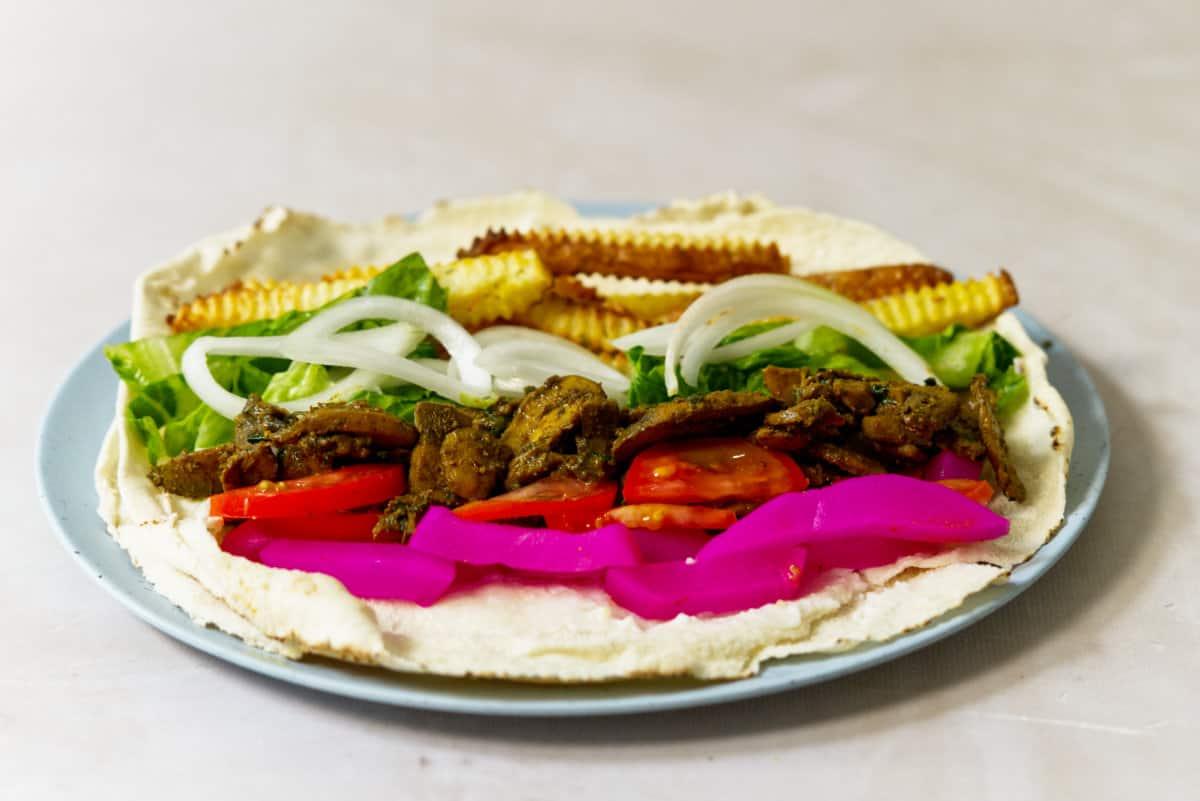 Veggie shawarma roll on a blue plate