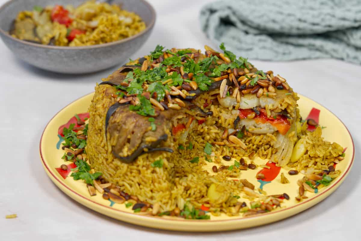 vegan maqlouba in a yellow plate