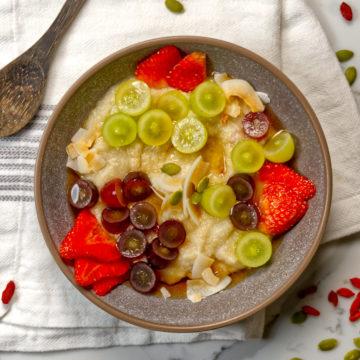 quinoa porridge in a bowl with fresh fruit