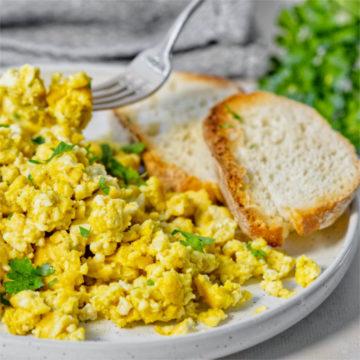 vegan egg scramble up close in a white plate