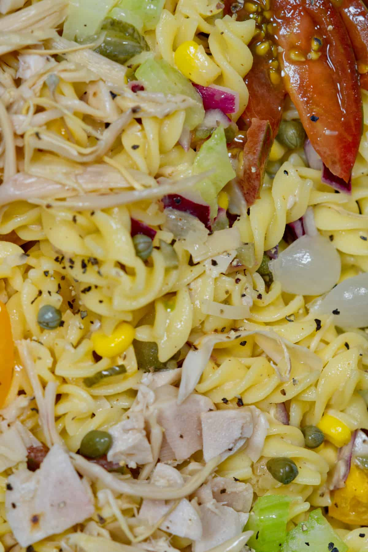 vegan pasta salad up close with banana blossom chopped up
