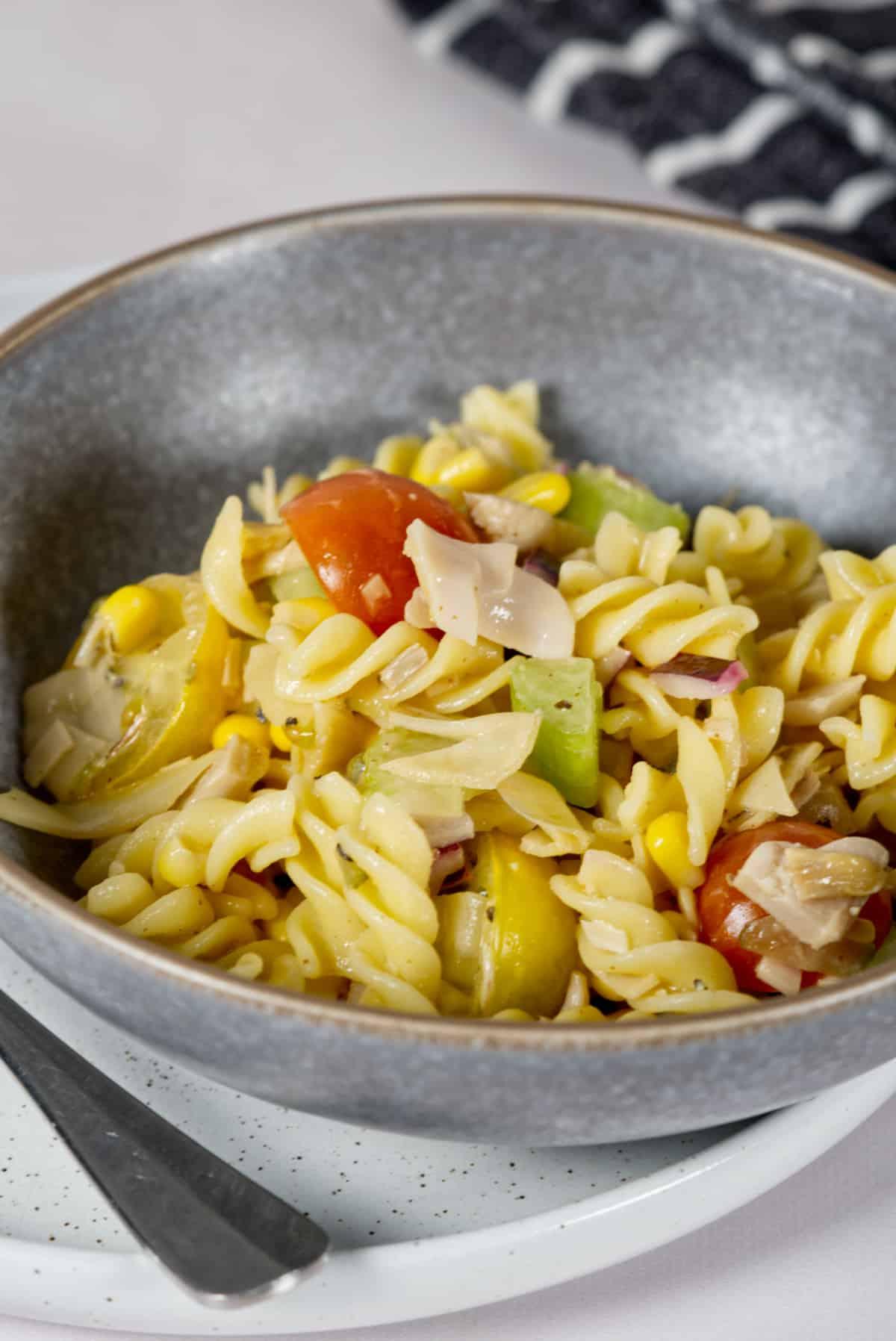 vegan pasta salad in a grey bowl