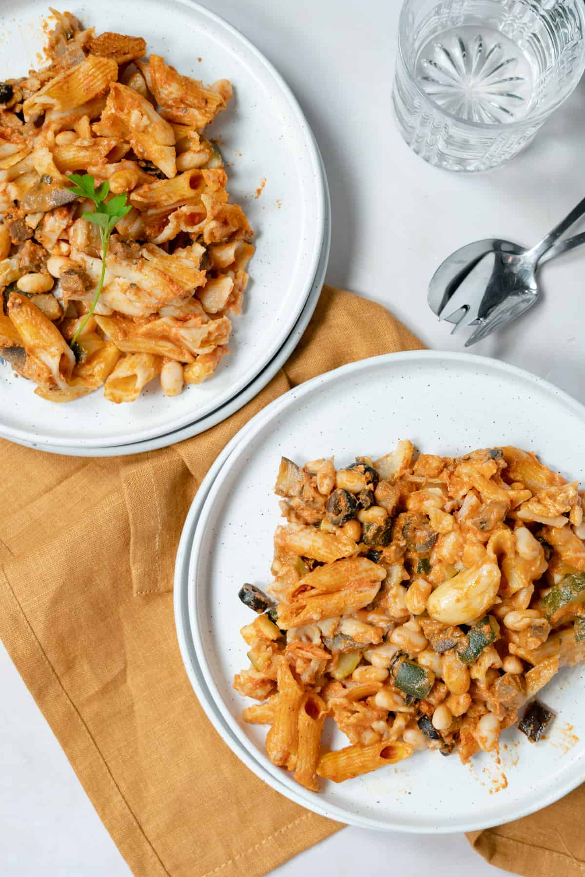 baked pasta in two white plates
