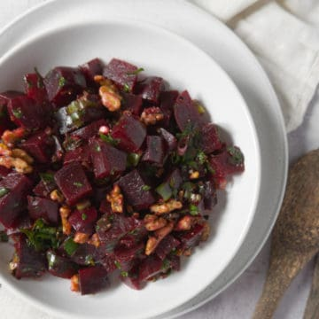 beetroot salad in a white bowl up close