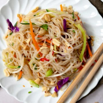 glass noodle salad up close in a white plate