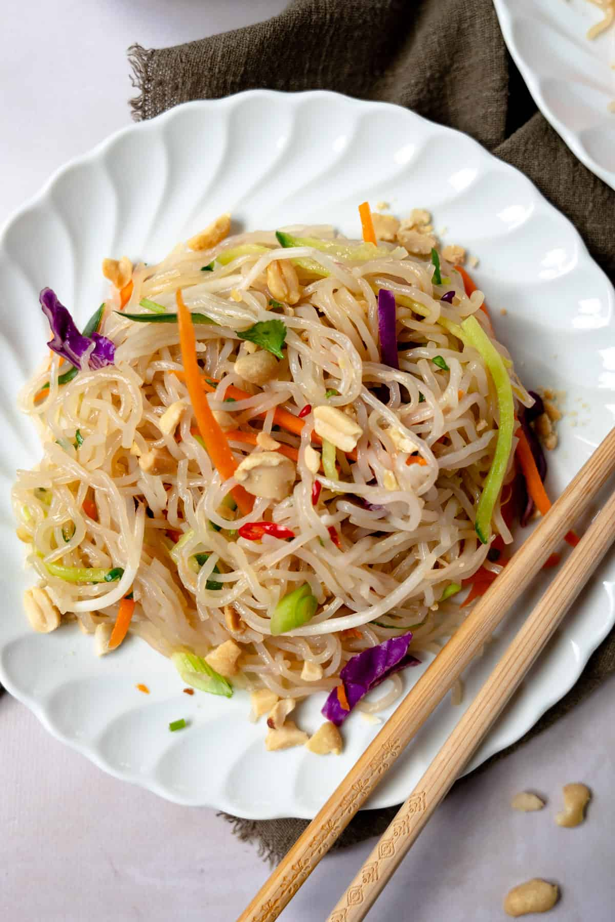 a plate of cold glass noodle salad with chopsticks