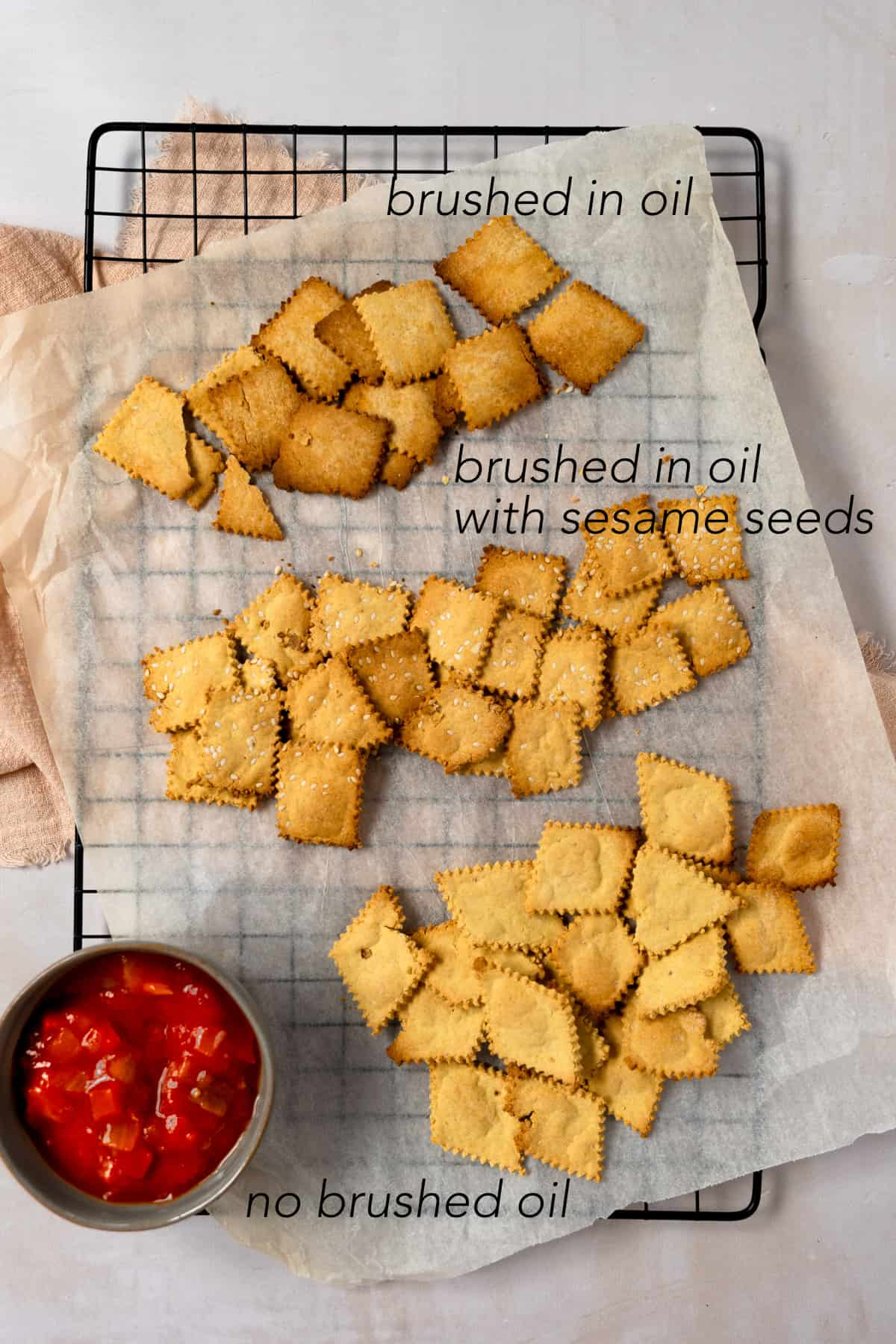 3 variations of gluten free crackers on a cooling rack