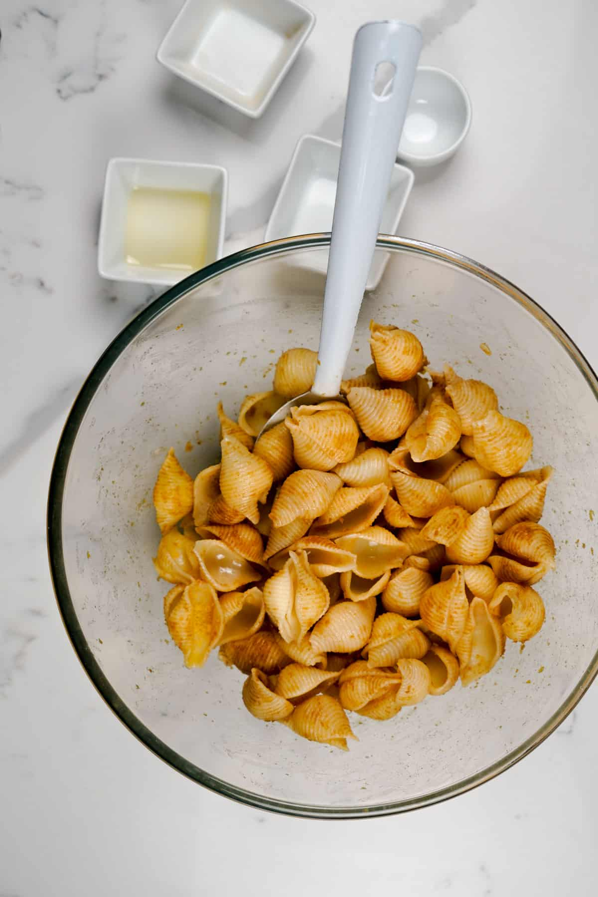 pasta chips in a bowl mix with oil and seasoning