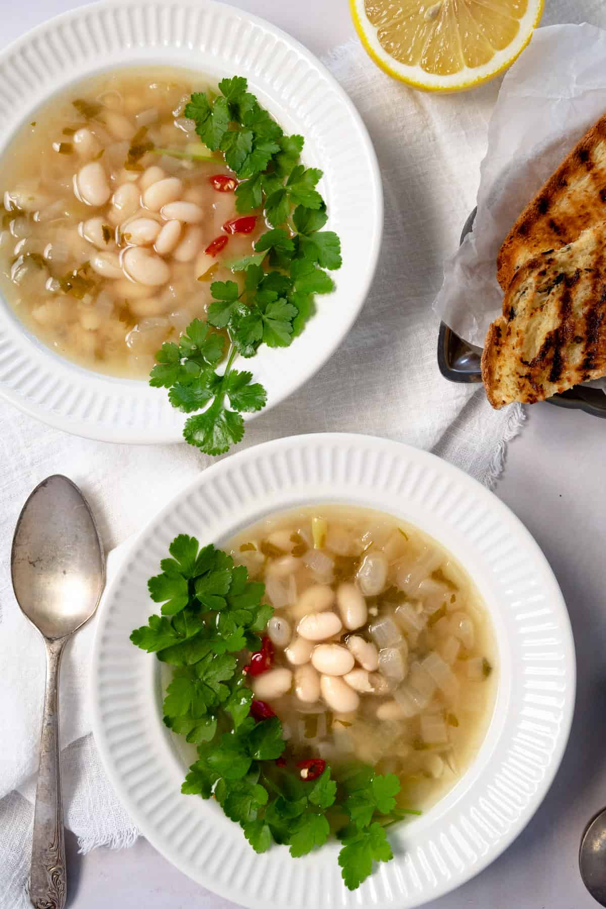 white bean soup in two white bowls