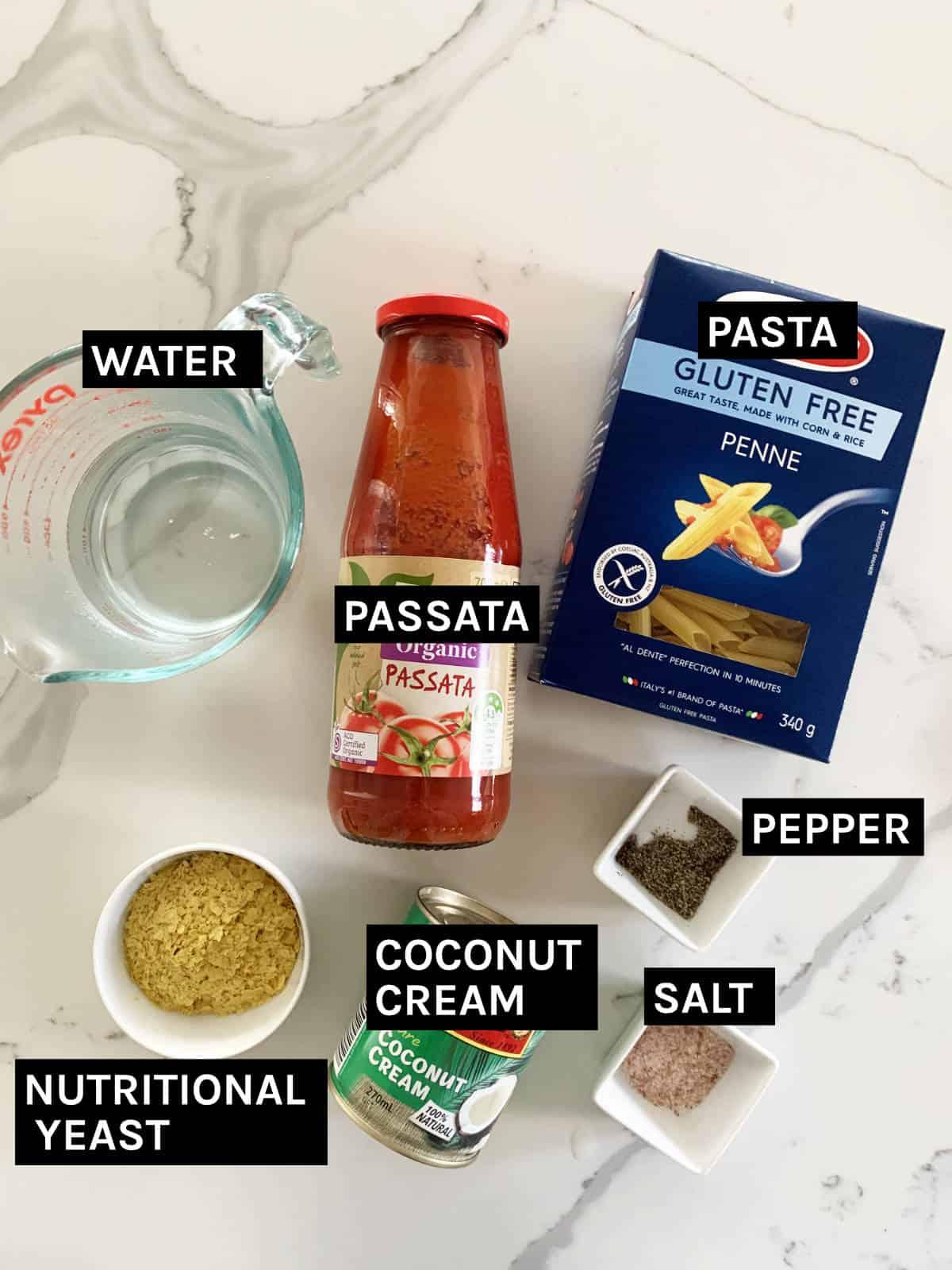 vegan pasta bake ingredients on flat surface