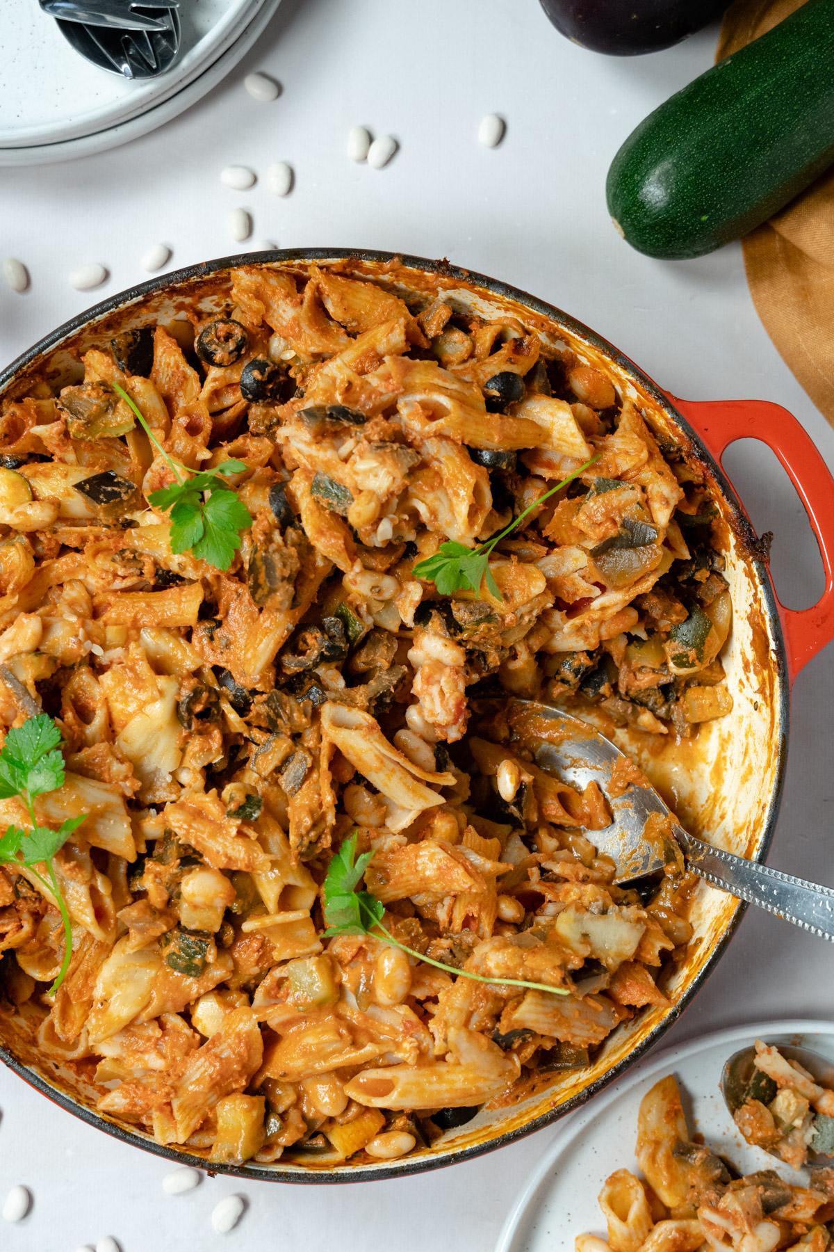 vegan pasta bake in a red casserole dish