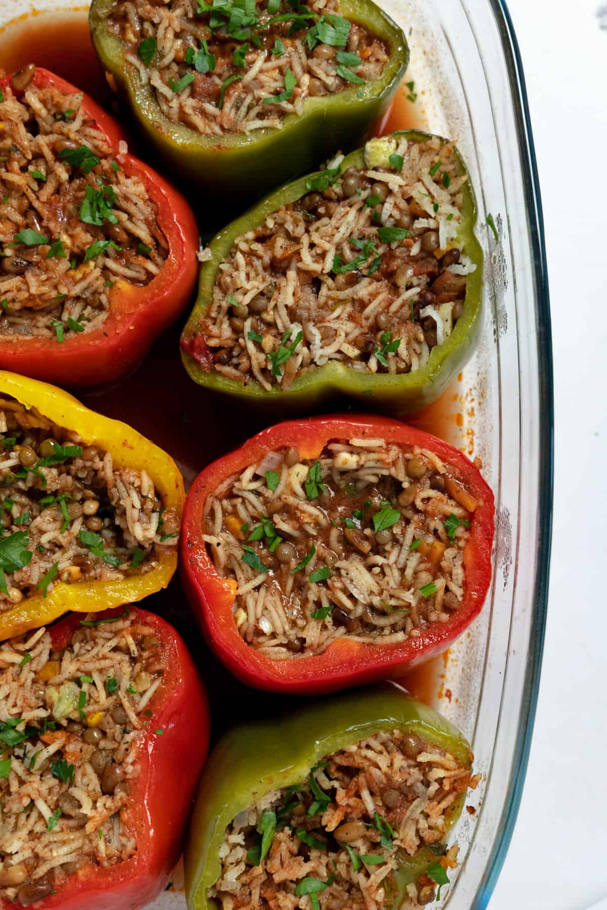 a top down view 6 stuffed capsicums filled with rice and lentils