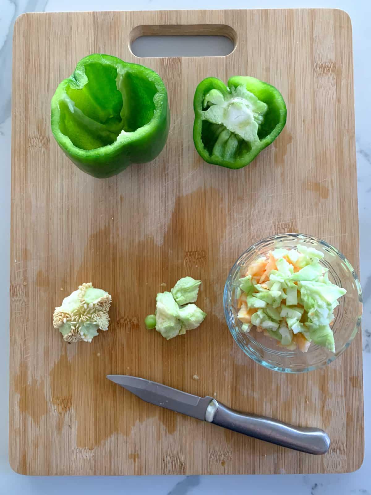cutting the core of a green capsicum