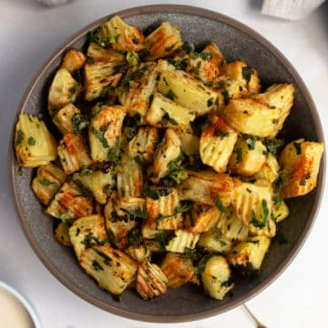 lebanese spicy potatoes in a grey bowl