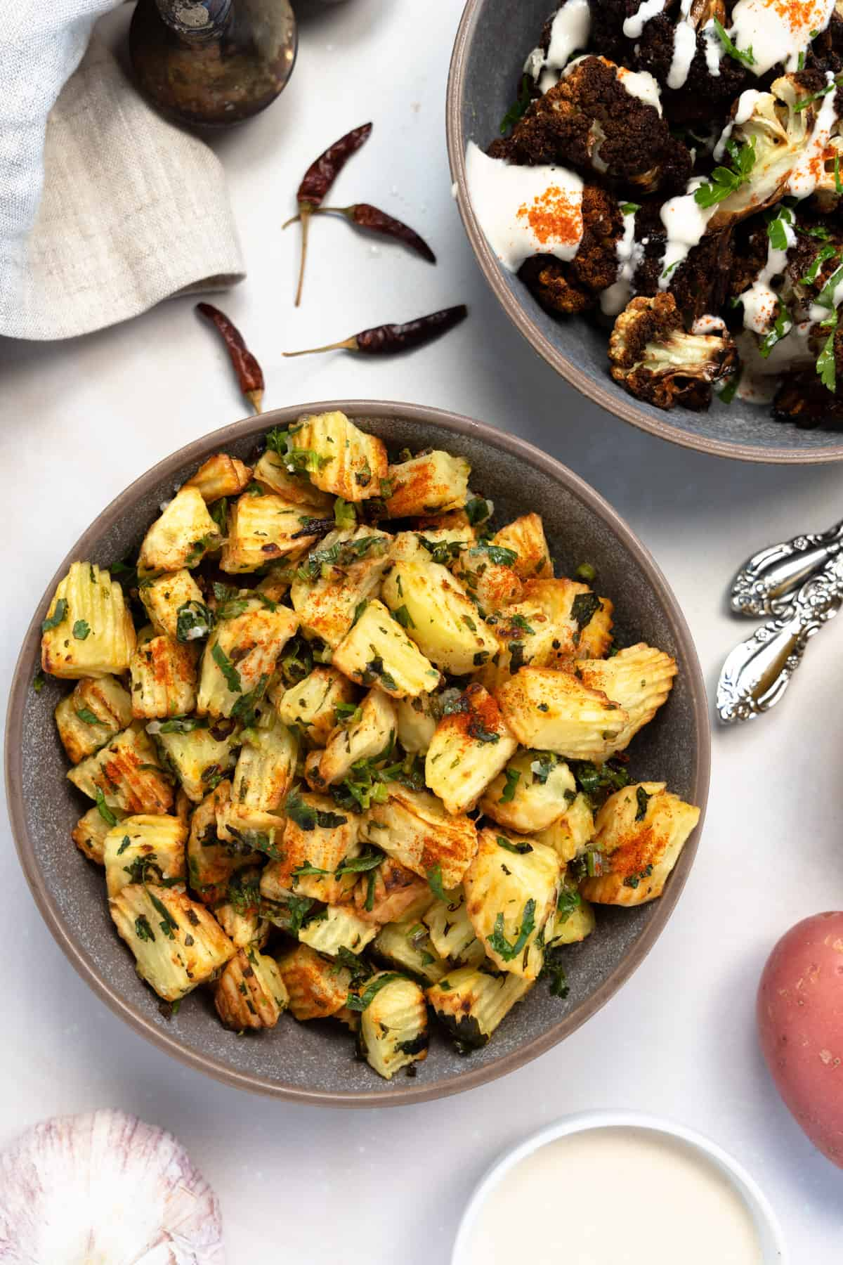 lebanese spicy potatoes and air fried cauliflower in two grey plates