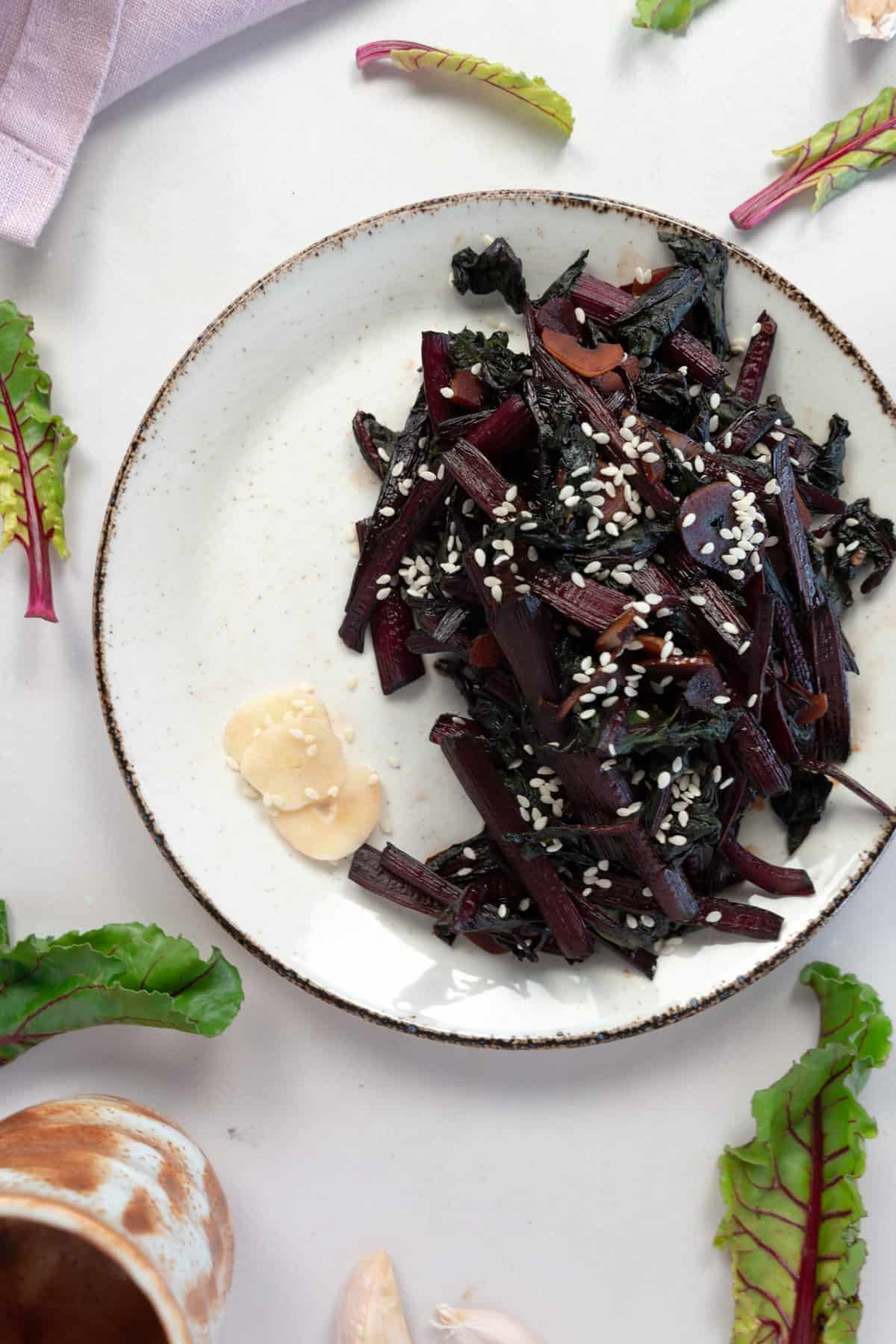 sauteed beetroot leaves on a white plate
